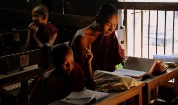 Monk learning integrity in Myanmar